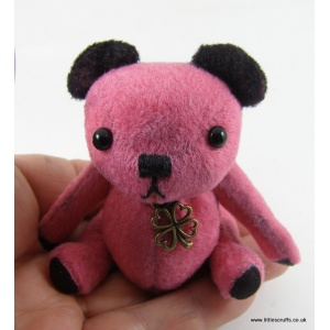 Winnie the pink bear with black ears