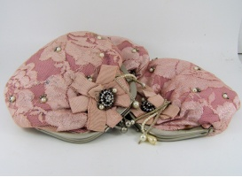 Pink vintage style purse with decoration on